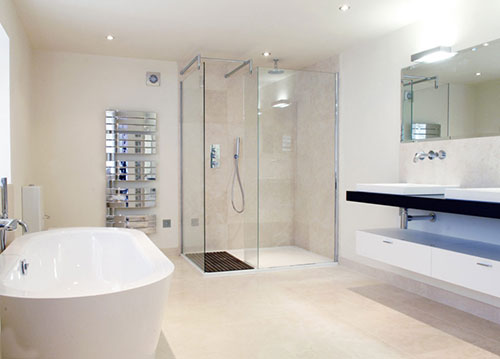 modern bathroom with limestone wall and floor