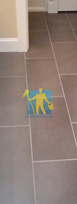 traditional bathroom with brown porcelain tiles rectangular with white grout lines melbourne
